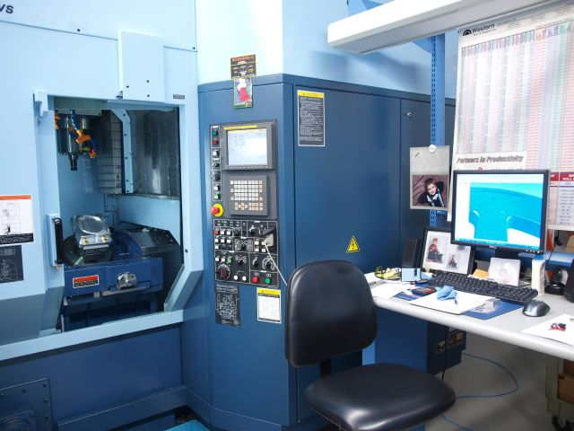 Precision Five Axis Mill With 40 Position Stocker